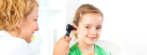 Audiologist with child